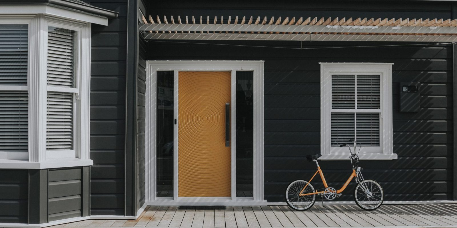 Front entrance of Villa Chartered Accountants with prominent yellow door and yellow bicycle leaning against the wall
